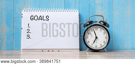 Alarm Clock With Goal Note Paper On Wooden Table Background And Copy Space For Text. Activity, Morni