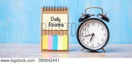 Alarm Clock With Daily Routine Note Paper On Wooden Table Background And Copy Space For Text. Activi