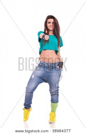 young sporty woman showing thumb up and holding a hand in her pocket