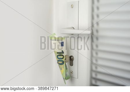 Money In A Door Key Ring. Save Money On Your Own House Or Apartment Concept