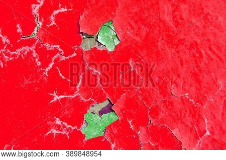 Texture background of red peeling paint, peeling paint texture. Texture background of peeling paint, red peeling paint on the texture surface,close up of peeling paint texture on the old texture background. Grunge texture surface with red peeling paint