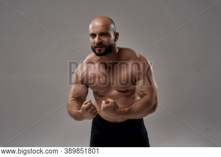 Strength. Muscular Strong Caucasian Man Bodybuilder Showing His Perfect Body, Chest, Biceps, Abs Whi