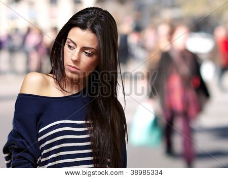 portrait of young girl standing at crowded street