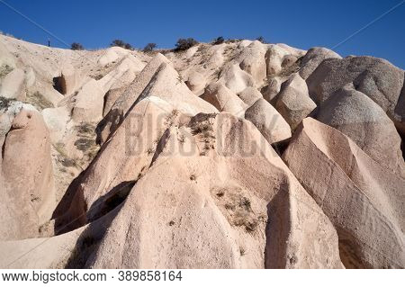 Rocky Geological Formations At Cappadocia, Turkey. Limestone And Tuff Rock Formations.