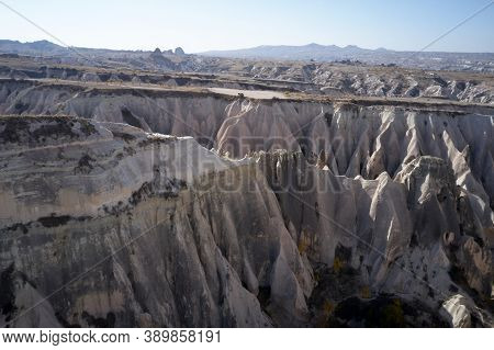 Volcanic Rock Formations Landscape. Scenic View Of Stone Formations In Valley At Cappadocia.