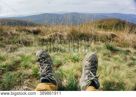 Mountain Trekking Background. Trekking Shoes Covered In Mud. Bieszczady National Park In Poland. Rel