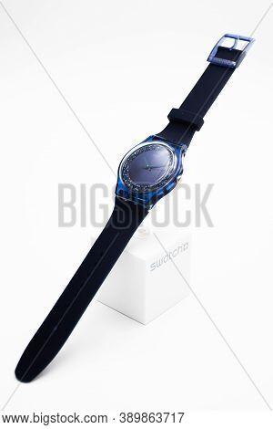 London, Gb 07.10.2020 - Swatch Swiss Made Quartz Watch On Stand. Transparent Plastic Case On Brand S