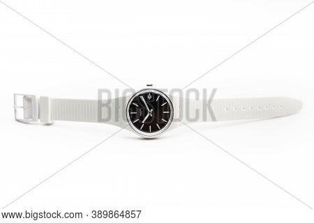 London, Gb 07.10.2020 - Swatch Swiss Made Quartz Watch Isolated On White Background. Date 19, Young