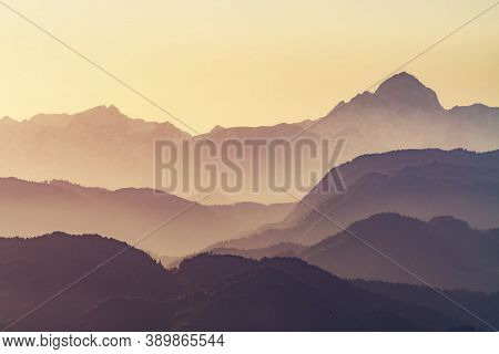 Beautiful Landscape Scene Of Layered Hills And Mountain Ranges, Visible Highest Peak Of Slovenian Al