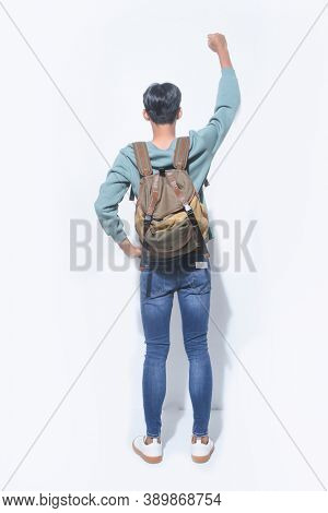 Full body young man student in casual clothes, with winner pose arms up ,backpack isolated on white background studio portrait. Education in high school university college concept