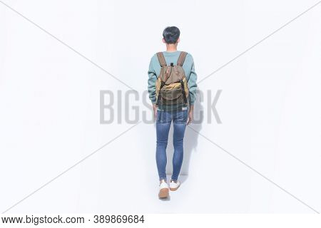 Full body young man student in casual clothes, with backpack isolated on white background studio portrait. Education in high school university college concept-back view