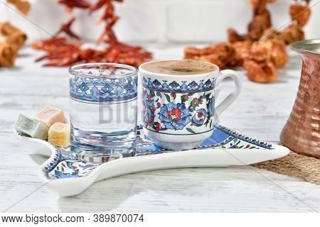 Traditional Turkish coffee served with Turkish delight on vintage background