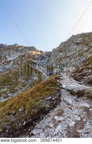 Tatra Mountains, Poland, 21/09/2020. Many Tourists Climbing Steep Trail With Chains Towards Szpiglas
