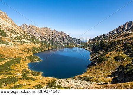 Crystal Blue Mountain Lake Wielki Staw In High Tatra Mountains, Autumn Mountain Landscape. Panorama