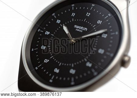 Paris, France 07.10.2020 - Swatch Logo On Black Wristwatch Dial Swiss Made Quartz Watch Isolated On