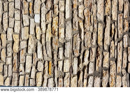 Vertically Aligned Limestone Wall Stone Blocks. Colorful Texture Of The Limestone Walls. Limestone W