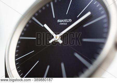 Geneve, Switzerland 07.10.2020 - Swatch Logo On Blue Wristwatch Dial Of Swiss Made Quartz Watch Isol