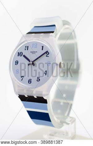 London, Gb 07.10.2020 - Swatch Cheapest Swiss Made Quartz Watch On Stand Close Up. Transparent Plast