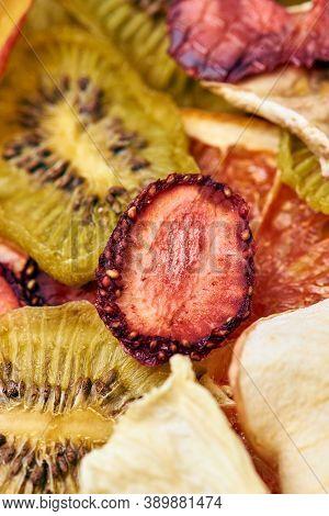 Close-up Mix Sliced Dried Fruits. Kiwi, Strawberry, Apple. Vegetarian Lifestyle.