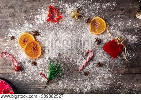 Christmas Food Background With Oranges, Star Anise And Flour On Wooden Background. Ingredients For C