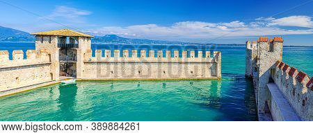 Sirmione, Italy, September 11, 2019: Small Fortified Harbor With Turquoise Water, Scaligero Castle C