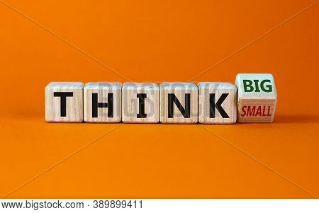 Think Small Or Think Big. Fliped A Cube And Changed The Words Think Small To Think Big Or Vice Versa