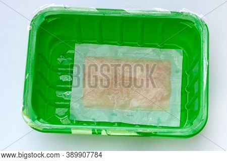 Absorbent Napkin In Green Plastic Tray. Perforated Absorbent Pads, Absorbent Liners For Meat, Fish A