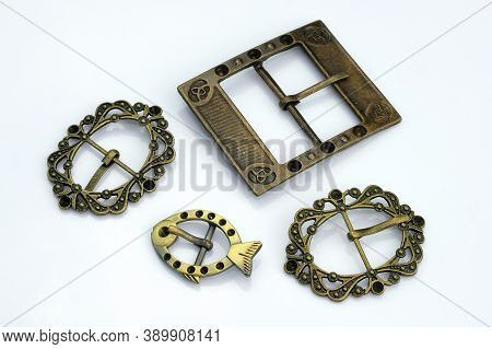 Decorative Buckles Made Of Metal. Bronze Decorations For Belts And Bags Decoration. Curly Metal Buck