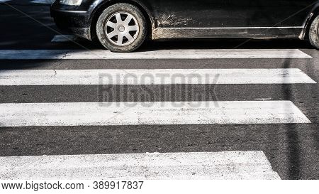 Car Driving On A Pedestrian Zebra Crossing,close-up.zebra Crossing Sign For On The Freeway.