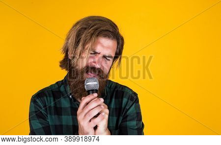 His Favorite Song. Rock Music. Male Karaoke Singer. Mature Charismatic Male Vocalist. Guy With Beard