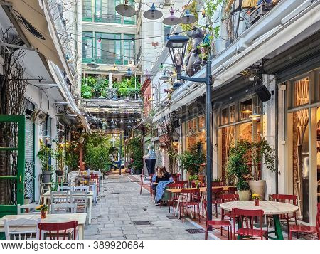 Thessaloniki, Greece - October 14 2019: Hellenic Dining Scene Of People At Outdoors Tavern Restauran