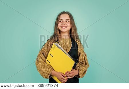 Nice Smile. Young Business Kid Holding Folder. Beautiful Brunette Girl With Folder Of Documents In H