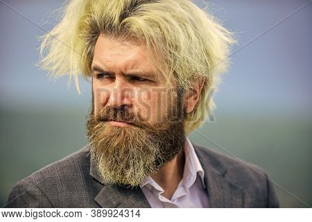 Serious Caucasian Hipster With Long Beard. Guy Looking Away. Thinking About Something Serious. Bache