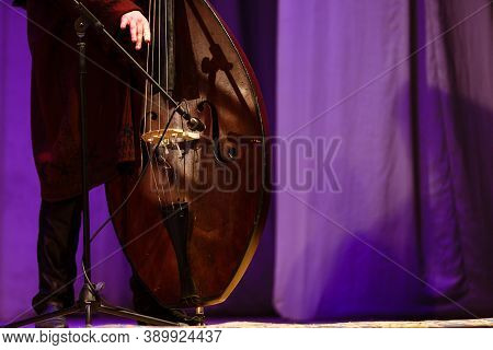 Acoustic Double Bass Player. Man Playing Double Bass On A Concert