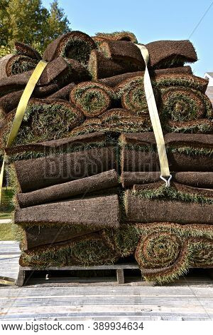 A Topsy-turvy Load Of Sod Is Strapped To A Wooden Pallet