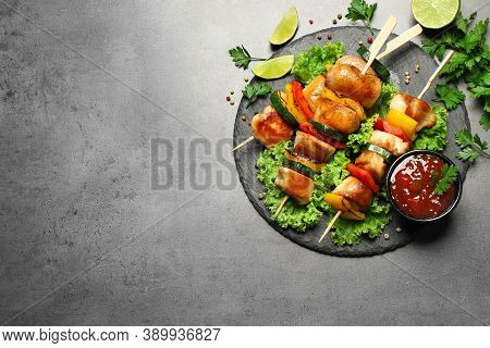 Delicious Chicken Shish Kebabs With Vegetables On Grey Table, Flat Lay. Space For Text