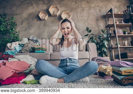 Full Length Photo Of Frustrated Anxious Girl Sit Legs Crossed Folded Carpet Have Laundry Iron Housew