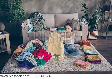 Top Above High Angle View Photo Of Focused Girl Sit Carpet Legs Crossed Folded Order Her Tidy Casual