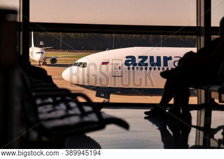 Moscow, Russia - 08 22 2020: Airplane Of Azur Air Behind The Window Of Vnukovo International Airport