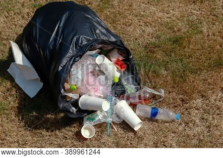 Bag Plastic And Plastic Waste On The Grass, Black Plastic Bag And Garbage Waste On Floor, Plastic Po