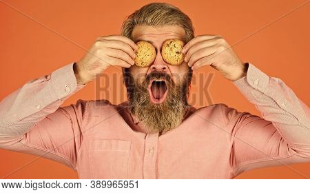 Cookies On His Mind. Bearded Man Hold Cookies On Eyes. Yummy Delicious Treats. Recipe Homemade Cooki