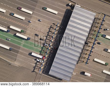 Top View Aerial Or Drone Shot Of An Overloaded Toll Road Or Tollway On The Controlled-access Highway