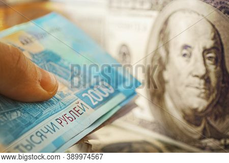 Exchange Of Dollar For Rubles. Currency Devaluation. Banknotes Close -up. The Concept Of The Financi