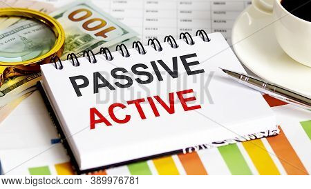 Passive Active Text.top View Office Table, Business Graph Show For Marketing Plan Have Book, Pen, Bl