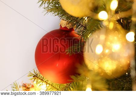 Christmas And New Year Background.golden And Red Decorative Ball And Glowing Shining Garlands Decora