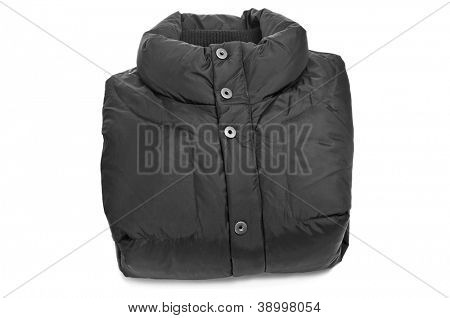 folded black quilted anorak on a white background