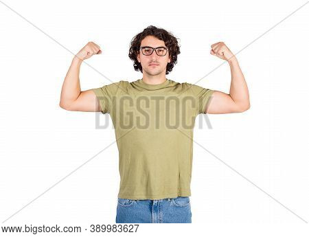 Confident Young Man Flexing Muscles Imagine Superpower. Strong Guy Wears Eyeglasses Shows His Streng
