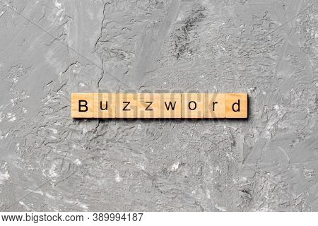 Buzzword Word Written On Wood Block. Buzzword Text On Cement Table For Your Desing, Concept