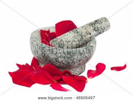Mortar with rose petals