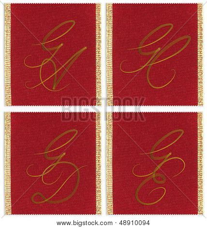 Collection of textile monograms design on a ribbon. JA, JC, JD, JE